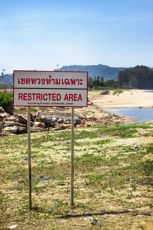strictly: Forbidden zone, adjacent to the airport, south-east Asia Editorial