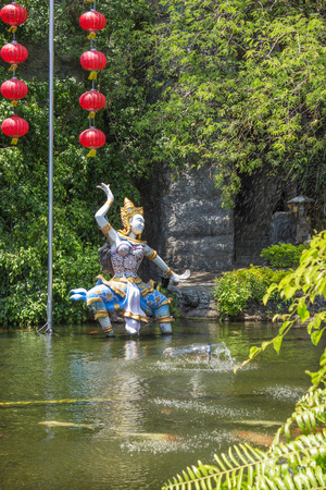 PHUKET, THAILAND - CIRCA MAR 2015: Mythological characters adorn the artificial pond. In Thailand  lot of bright and lovingly made heroes fairy tales Redakční