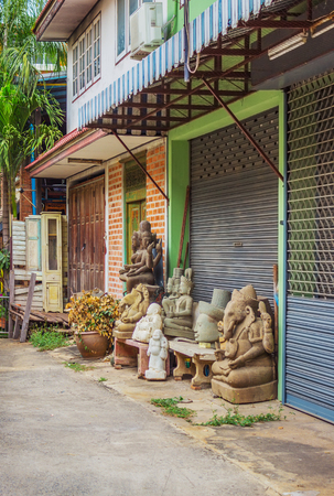 In a small shop sold sculptural images of deities.Thailand. Bangkok Stock Photo