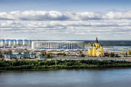 oka: Russia, Nizhny Novgorod - Sep 24, 2017: View from the high bank of the Oka River to the stadium under construction and the Alexander Nevsky temple