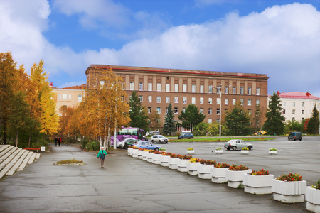 Apatity, Russia - September 14, 2012: Geological Institute and a small area in front of him in the city of Apatity. Autumn here comes early