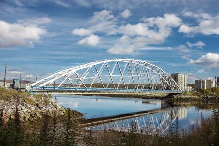 Iron Bridge through Tuloma. City Cola. North of Russia
