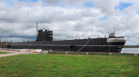 Vytegra, Russia - Sep 16, 2012: Diesel submarine B-440 of seventies, established as a monument and a museum near shore of  reservoir in  city of Vytegra