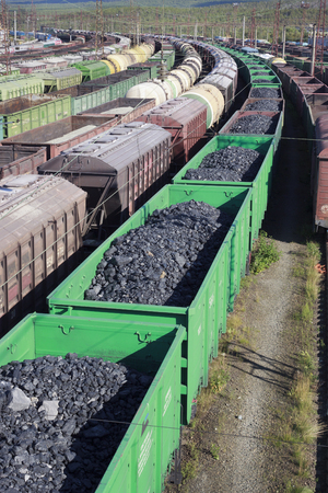 Kandalaksha, Russia - August 29, 2012: Kandalaksha train station is a major transportation hub in the Russian Arctic Circle. Wagons with coal on rail tracks