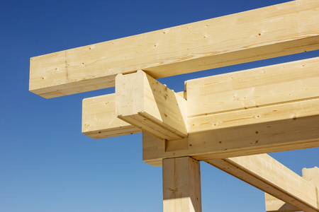 Construction of a wooden beam. Assembling. Angle of log house Imagens