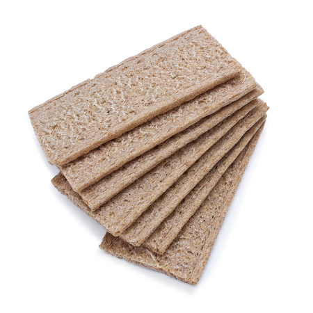 Appetising crispbread with bran lie of white background