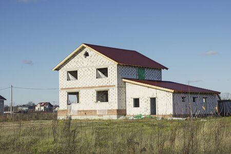 Under construction house of aerated concrete blocks. Development of the land plot. Russia