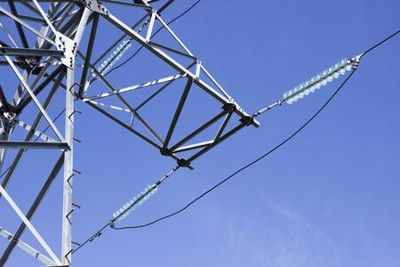 Traverse high voltage power transmission lines and Insulators made of glass