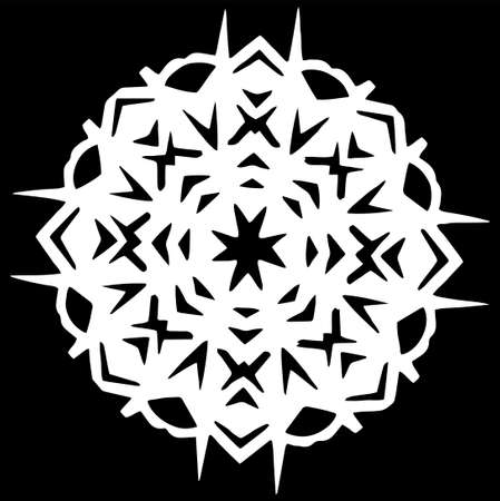 Paper white snowflake lie on black background. Cut out of paper