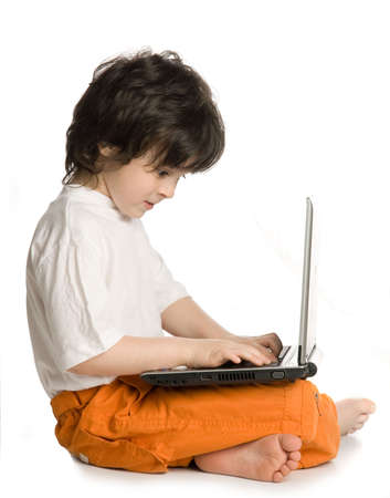 The merry  boy with laptop on white background photo