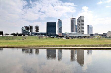 Panorama the business district in Vilnius. White bridge. Neris river