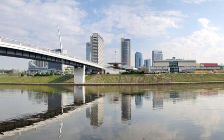 Panorama the business district in Vilnius. White bridge. Neris river photo