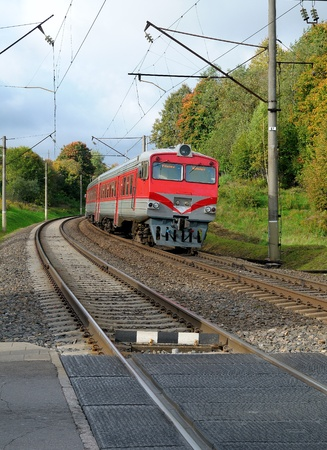 midday: Train on a railway. Autumn midday. Railway in a Lithuania