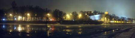 Vilnius panorama at night. City lights reflection in the river photo