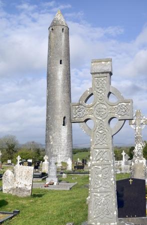 Ruins of Kilmacduagh Monastery Tower, County Galway, Ireland  Celtic cross Stock Photo - 13899744