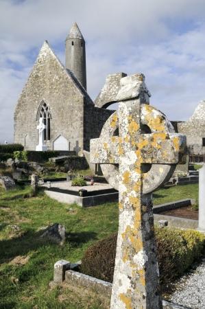 Ruins of Kilmacduagh Monastery, County Galway, Ireland  Celtic cross