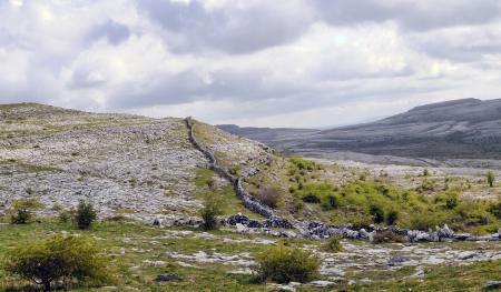 The Burren is a karst-landscape region in northwest County Clare, in Ireland  Irish fences Stock Photo - 13899753