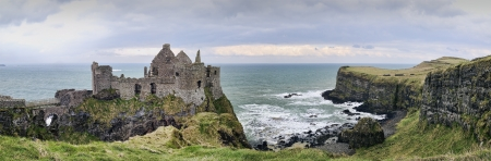 castle rock: A panorama with details from the famous Dunluce Castle back lit - a landmark from County Antrim, Northern Ireland  Stock Photo