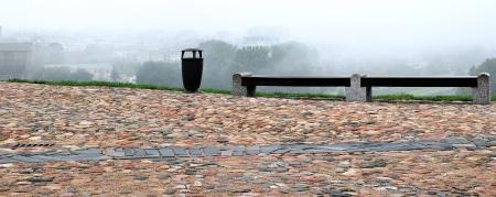 wastebasket: Castle hill of Gediminas, sidewalk of boulders  Wastebasket and two wet bench
