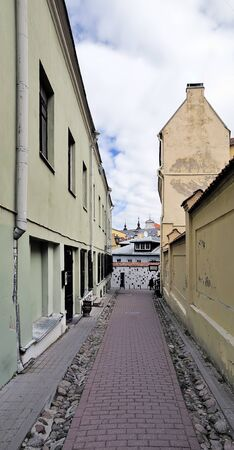 vibrance: Narrow small  Literatu  street of the old city in Vilnius