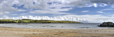 Fintra beach is a beautiful sandy beach just a couple of kilometers outside the fishing port of Killybegs  Stunning views of both the beach and Donegal Bay as far as Benbulben mountain in County Sligo Stok Fotoğraf