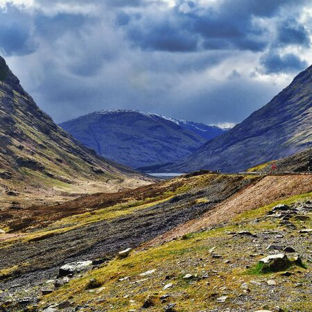 midday: Glencoe valley, midday. Spring season, april. Sunshine and cloudy sky. Stock Photo