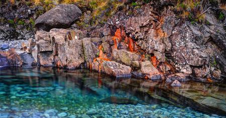 Rusted rocks in Fairy Pools, Glen Brittle, Isle of Skye, Inner Hebrides, Highlands, Scotland Stock Photo
