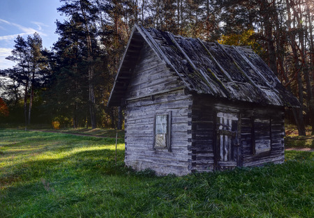 Old wooden house ruins in lithuanian village. Lithuania, Vilnius county. Stok Fotoğraf