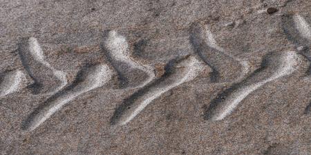Sand texture in a beach, wheel protector draw. Stok Fotoğraf