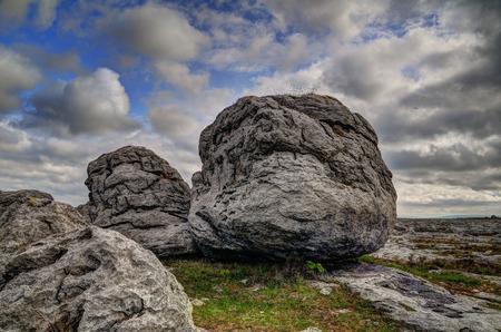 Dragon head. The Burren is a karst-landscape region or alvar in northwest County Clare, in Ireland. Boulders.