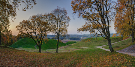 Autumn sunrise over Kernave hills. KernavÄ— was a medieval capital of the Grand Duchy of Lithuania and today is a tourist attraction and an archeological site