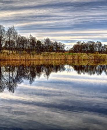 Karvys lake in Vilnius municipality, near Maichiogala. Lake borders village Karvys . Stok Fotoğraf