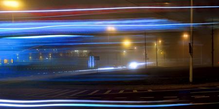 Overnight street lights in foggy Vilnius Stok Fotoğraf