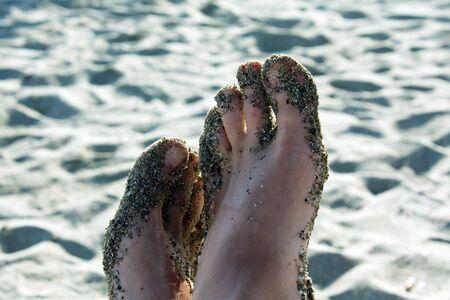 Feet in sand Stock Photo