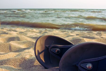 Slippers on shore photo