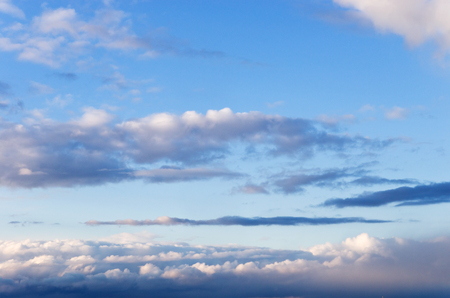 Clouds on dark blue sky