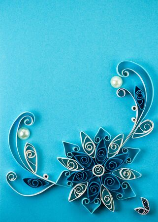 Quilling pattern on a blue background