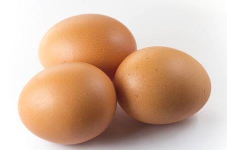 Three eggs on a white background