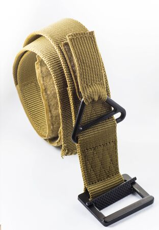 Military belt on a white background Stock Photo