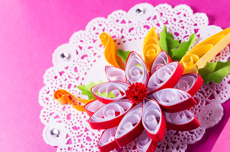 Bright quilling in the form of a flower