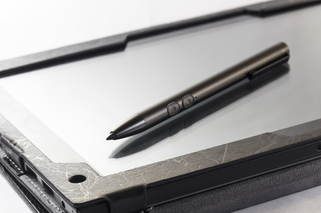 The stylus lies on the screen of the tablet Stock Photo
