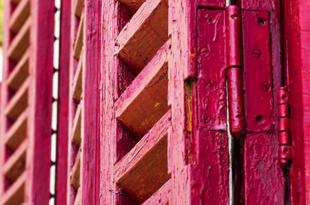 Old wooden shutters in red color