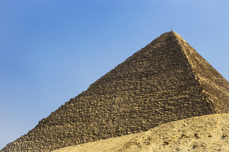 cheops: Pyramid of Cheops against the sky Stock Photo