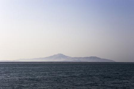 Tiran Island on the horizon in the Red Sea