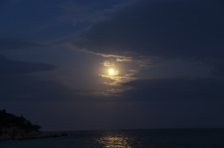 Night seascape with moon in the sky