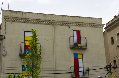 House with multi-colored windows on the balcony