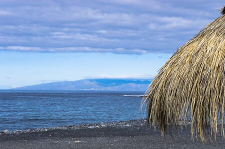 Part of the beach umbrella against the sea, Tenerife Archivio Fotografico - 132073683