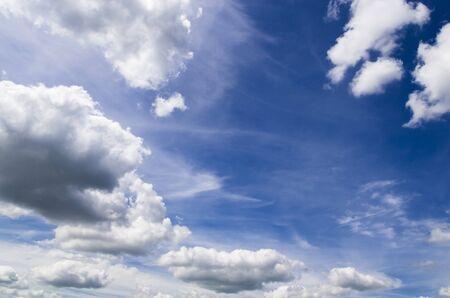 White clouds in the blue sky Archivio Fotografico - 132074195