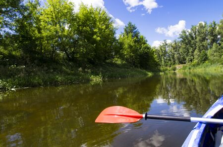 Kayak paddle above the water, river Archivio Fotografico - 132073963