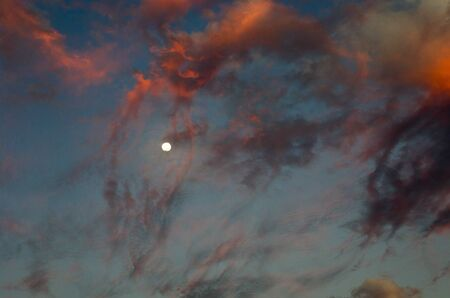 Heavenly sunset landscape with the moon Archivio Fotografico - 132072784